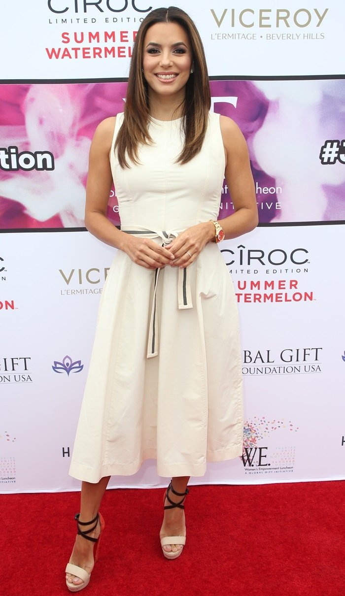 Eva Longoria poses for photos while attending the Global Gift Foundation's Women Empowerment Luncheon