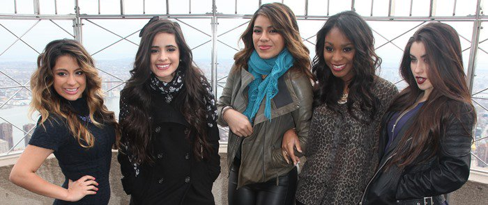 Ally Brooke, Camila Cabello, Dinah Hansen, Normani Hamilton, and Lauren Jauregui of Fifth Harmony pose at the Empire State Building for a promotional event