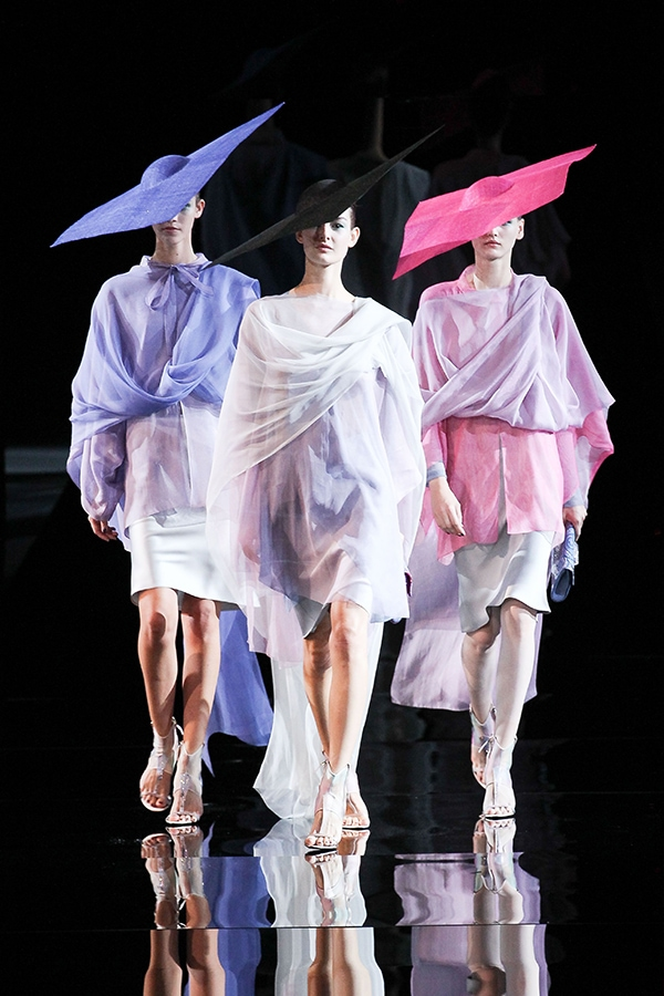 Stunning dresses and oversized square hats fascinated the audience