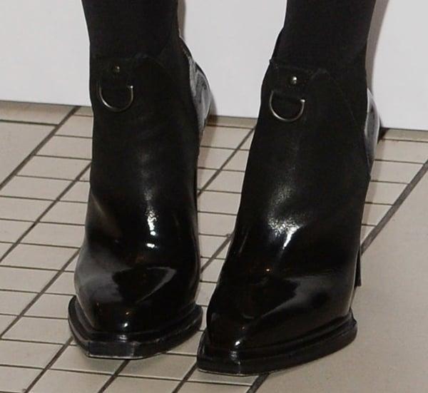 Hailee Steinfeld wearing cutting-edge McQ Alexander McQueen patent suede booties