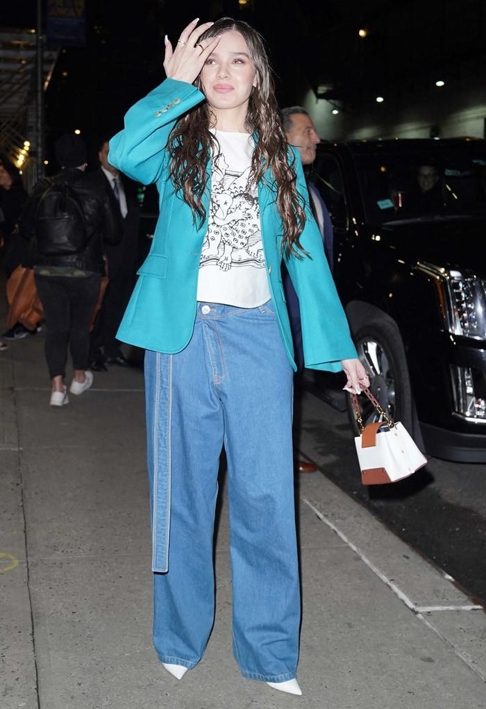 Hailee Steinfeld wearing Lanvin oversized asymmetric wide-leg jeans