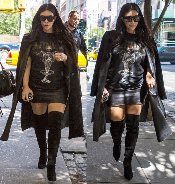 Kim Kardashian rocking a long black coat, black knee-high boots, and a Metallica t-shirt