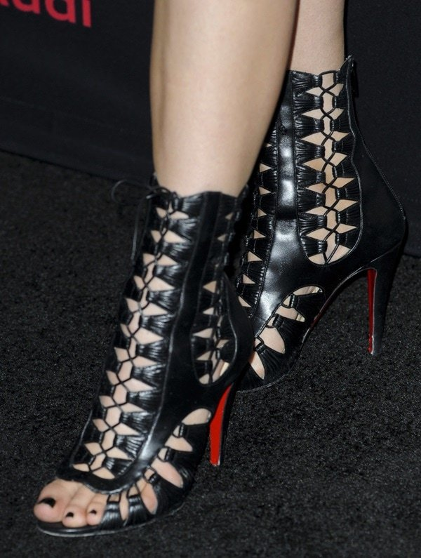 Kylie Jenner shows off her black pedicure in a pair of Christian Louboutin lace-up booties
