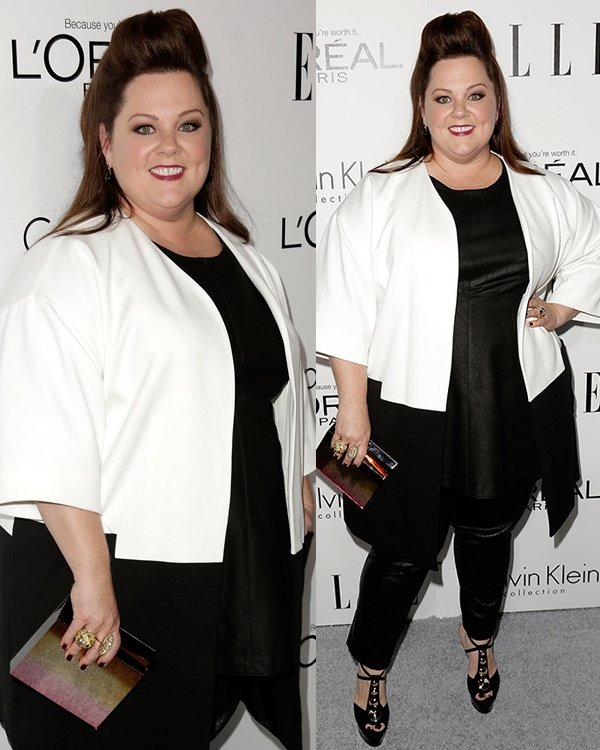 Melissa McCarthy did well by choosing a black leather top with black pants under a pretty black-and-white coat