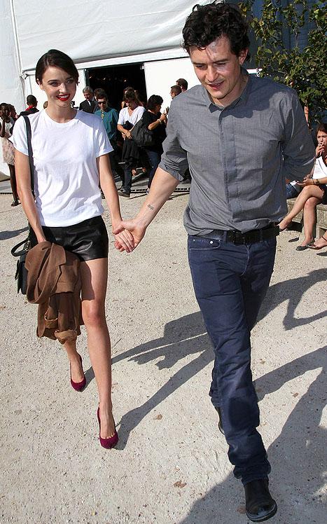 Miranda Kerr and Orlando Bloom leave the Christian Dior spring/summer 2012 fashion presentation at Paris Fashion Week