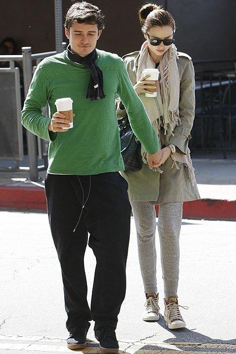 Orlando Bloom grabs Miranda Kerr's hand as the brunette haired beauty crosses the street