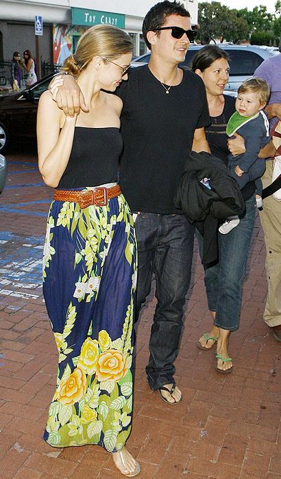 Miranda Kerr shows off a bold patterned skirt as she leaves Taverna Tony in Malibu, California, with Orlando Bloom