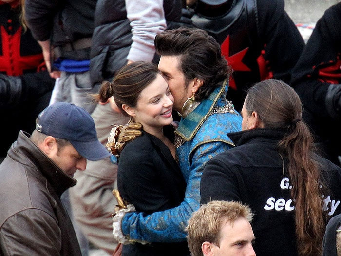 Miranda Kerr and Orlando Bloom embrace on the set of The Three Musketeers at Residenz Wuerzburg