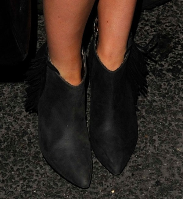 Mollie King wearing fringe boots by Betsey Johnson