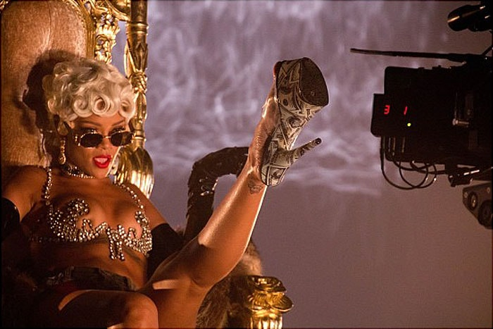 """Rihanna showing her dollar-printed stripper heels to the camera while shooting her """"Pour It Up"""" music video"""