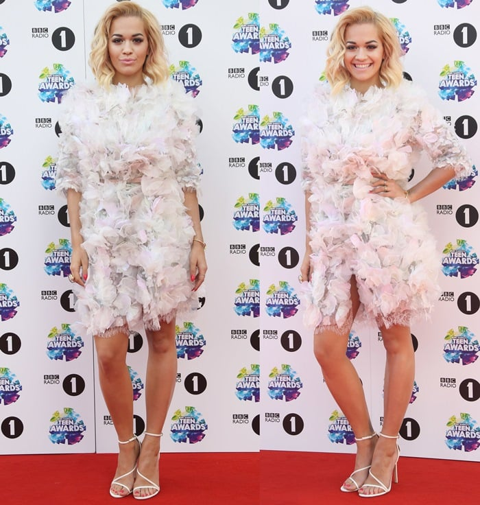 Rita Ora flaunts her legs in a frilly embellished dress from the Marchesa Spring 2014 collection