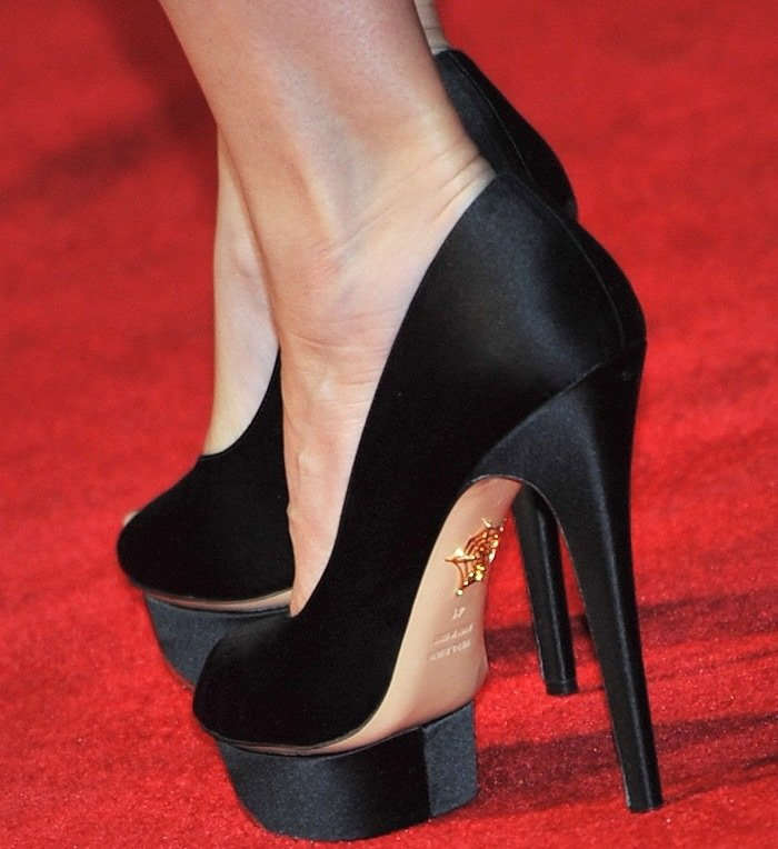 Sandra Bullock completes her red carpet look with a pair of Charlotte Olympia platform pumps