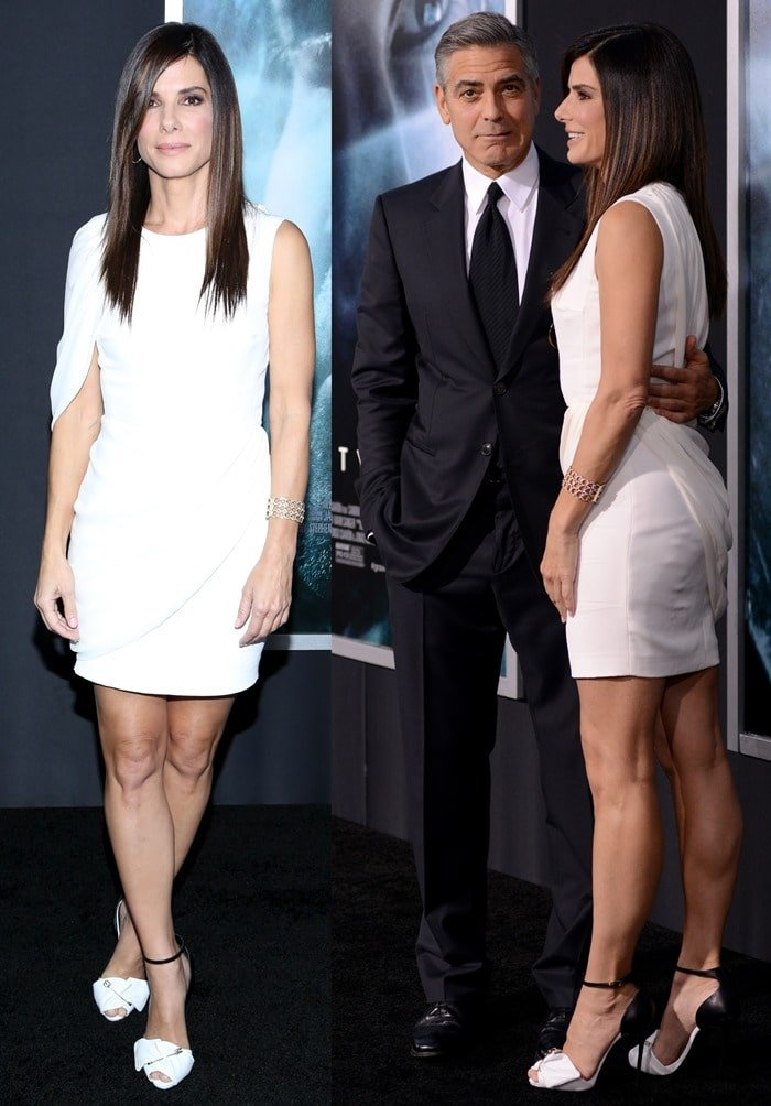 Sandra Bullock, with George Clooney, looking classy in a white dress and black-and-white pumps at the premiere of 'Gravity' held at AMC Lincoln Square Theater in New York City, New York, on October 1, 2013