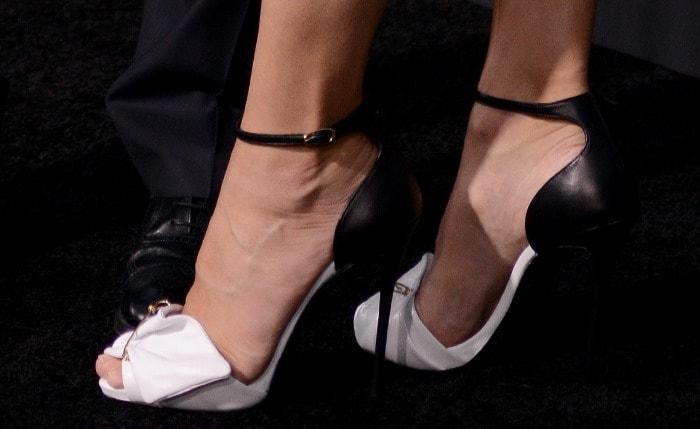 Sandra Bullock wearing monochromatic sandals from Giuseppe Zanotti