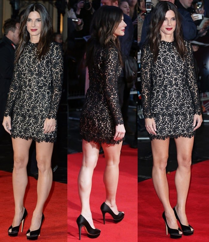 Sandra Bullock shows off her legs in an intricate floral minidress from Stella McCartney