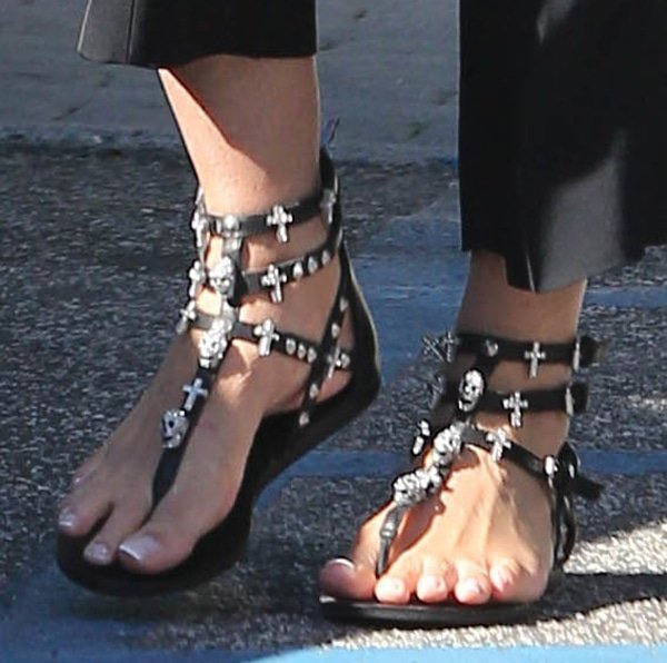 Sharon Stone's gladiator sandals feature spiked studs and crystal-encrusted skull and cross embellishments