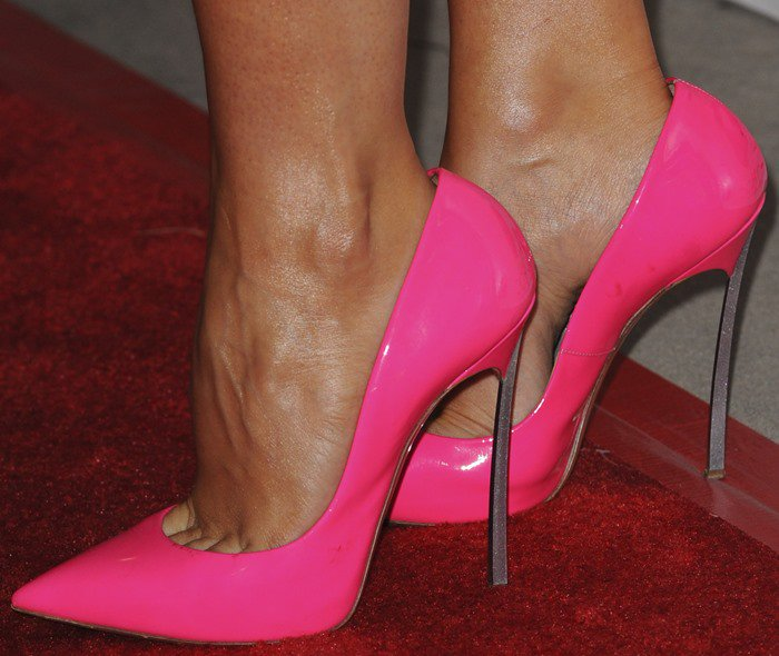Stana Katic shows off her feet in neon pink Casadei pumps