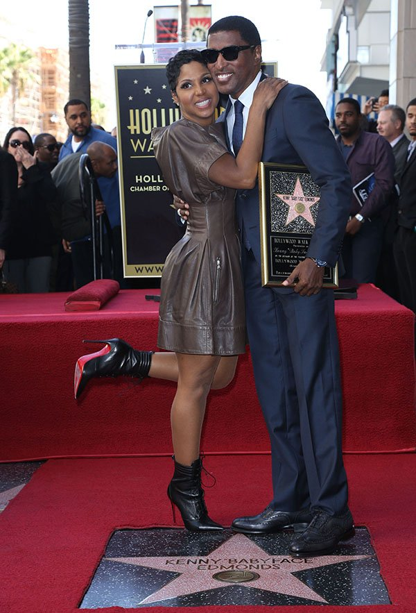 """oni Braxton with Kenny """"Babyface"""" Edmonds at a ceremony honoring him with the 2,508th star on the Hollywood Walk of Fame on October 10, 2013"""