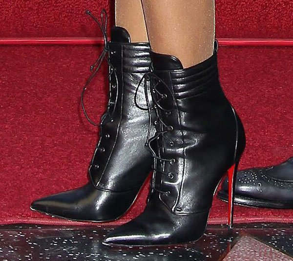 Toni Braxton showing off her hot legs in Christian Louboutin Mado ankle boots