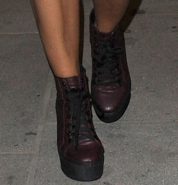 Vanessa White wearing platform lace-up boots