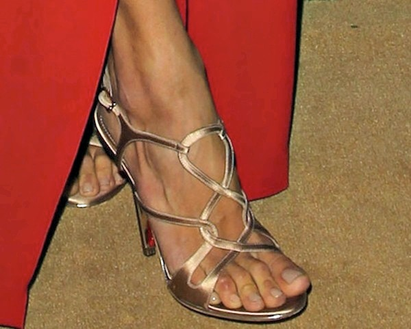 Alessandra Ambrosio's feet in strappy sandals in champagne satin