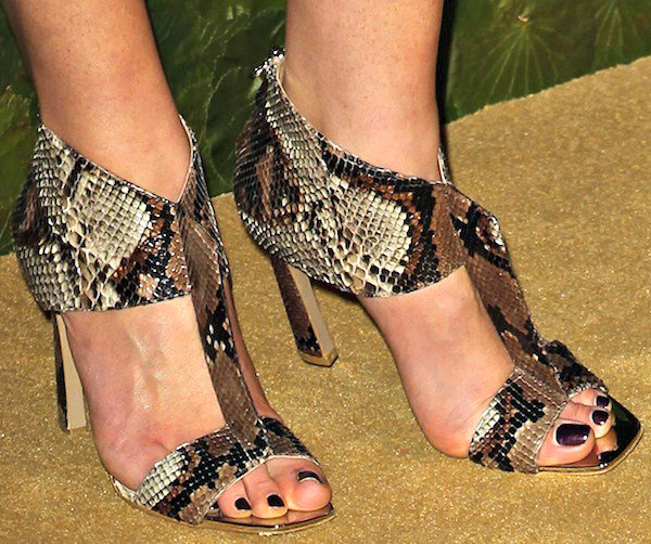 Anne Vyalitsyna's feet in snakeskin sandals