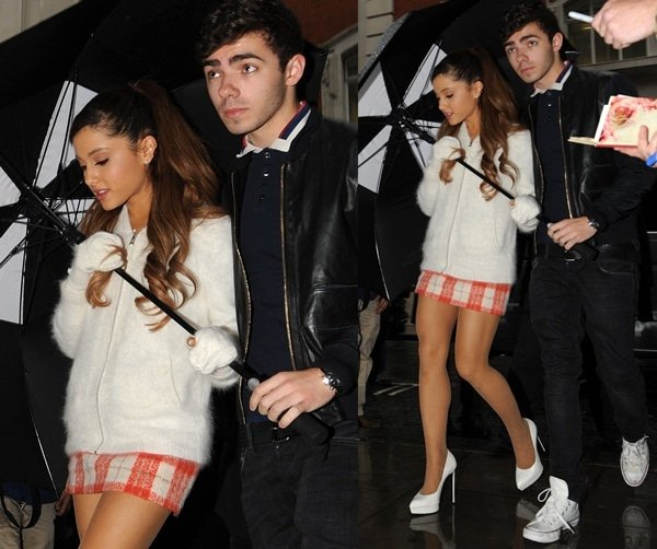 Ariana Grandein a cozy white sweater and a plaid Topshop skirt