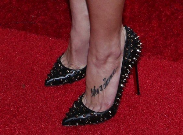 Ashley Greene wearing wearing black Pigalle Spikes pumps