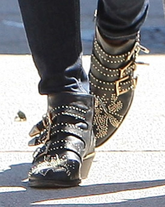 Ashley Greene paired herstudded buckled boots with jeans