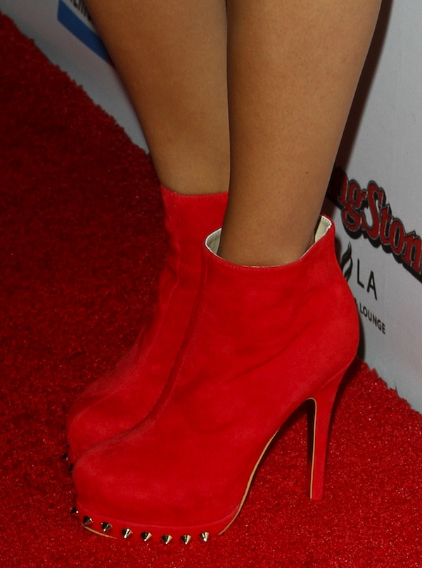 Ashley Madekwe wearing Kandee 'Rosso Red' suede booties with gold studs