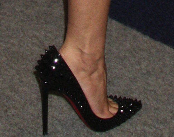 Aubrey Plaza wearing wearing black Pigalle Spikes pumps