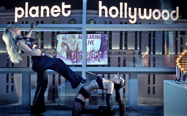 Britney plugging her (future) gig at Planet Hollywood while showing off her Giuseppe Zanotti cap-toe pumps