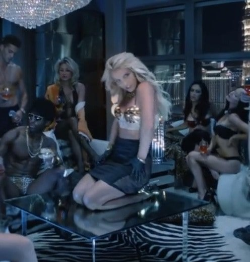 Britney dancing on the table while wearing gold Giuseppe Zanotti pumps