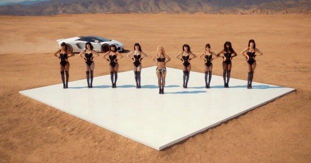 Britney Spears wearing Giuseppe Zanotti sneaker wedges as she dances in the desert