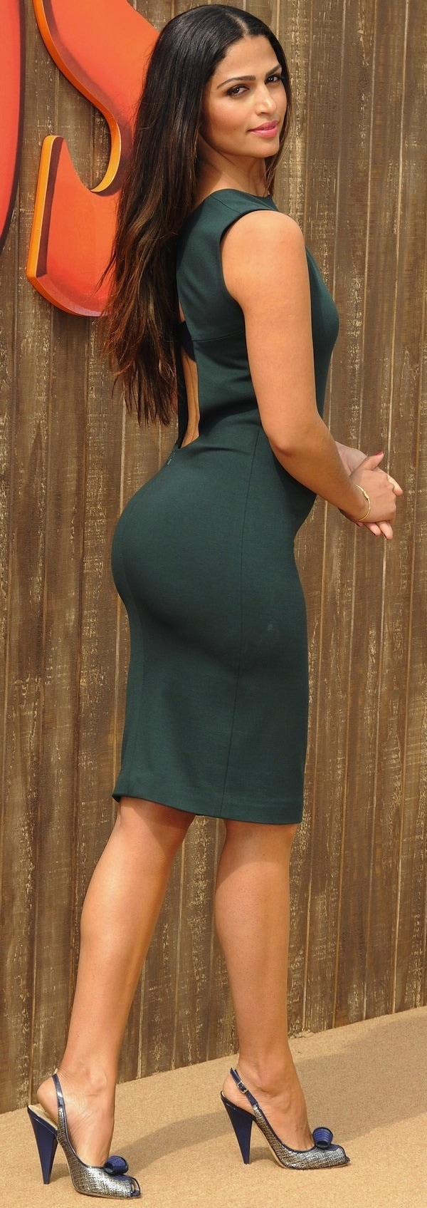 Camila Alves looking stunning in a backless sleeveless dark green dress