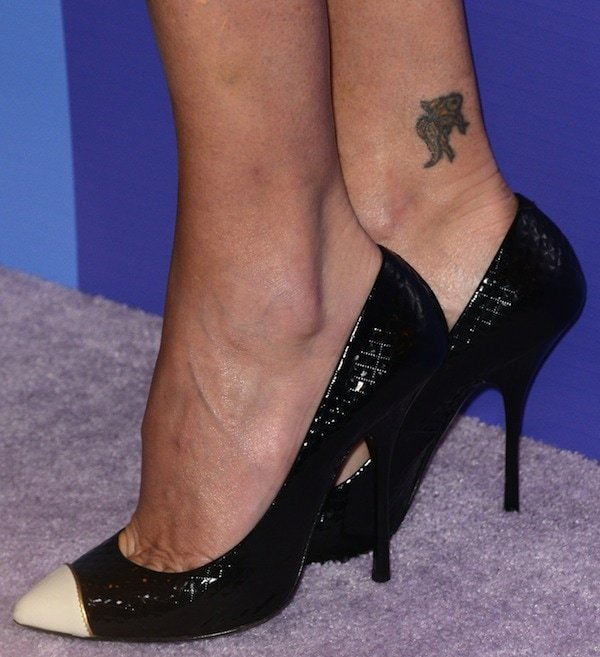 Charlize Theron shows off her feet in black Giuseppe Zanotti high heels