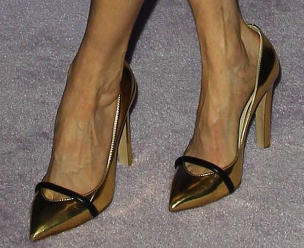 Darby Stanchfield wearing gold Ruthie Davis 'Narcissus' pumps