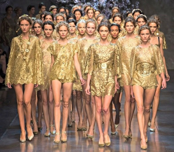 Models in head-to-toe gold at the finale for Dolce & Gabbana's Spring/Summer 2014 ready-to-wear collection fashion show