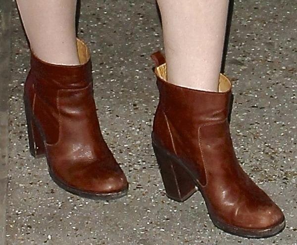Elle Fanning wearing Maison Martin Margiela ankle boots