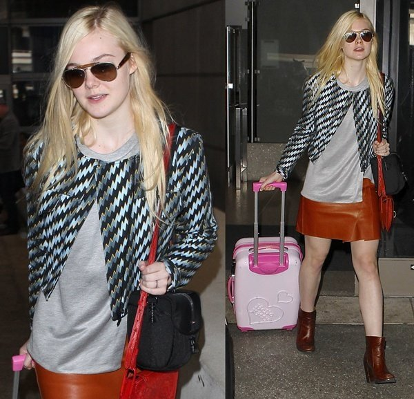 Elle Fanning wearing a Kenzo printed jacket, a Phillip Lim leather pencil skirt, and Maison Martin Margiela ankle boots