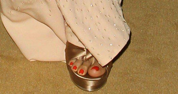 Freida Pinto's pedicured toes insatin platform sandals