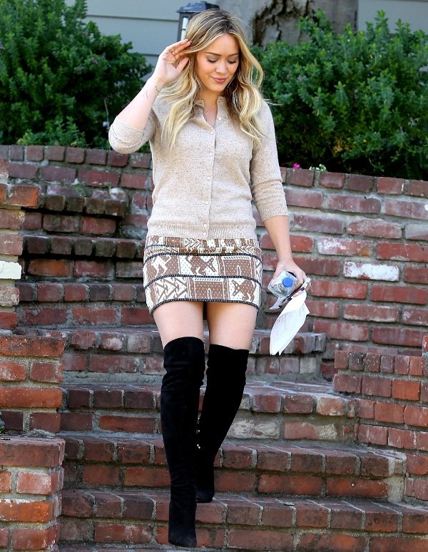 Hilary Duff wore a light brown sweater over a tribal-print miniskirt