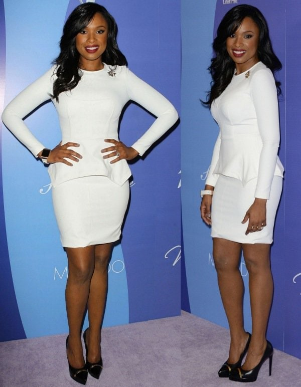 Jennifer Hudson wearing a white long-sleeved dress with a peplum detail from the Yigal Azrouël Fall 2013 collection and black pumps from Saint Laurent