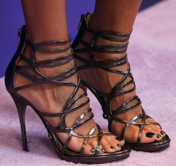 Jessica Alba shows off her feet in metallic high heels