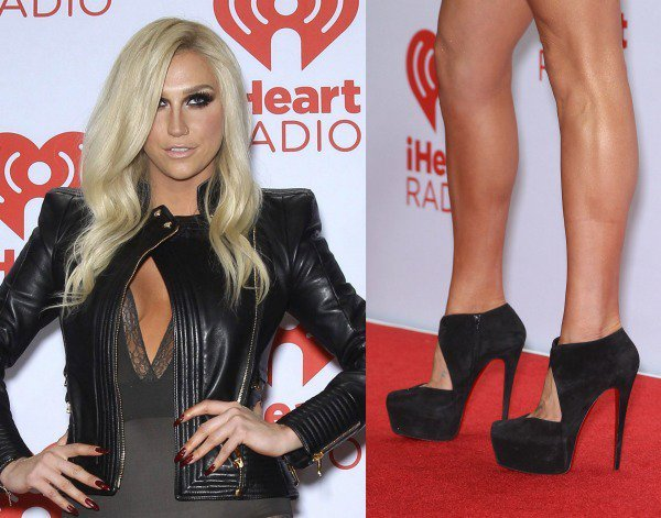 Kesha completes her edgy ensemble with a towering pair of black platform pumps