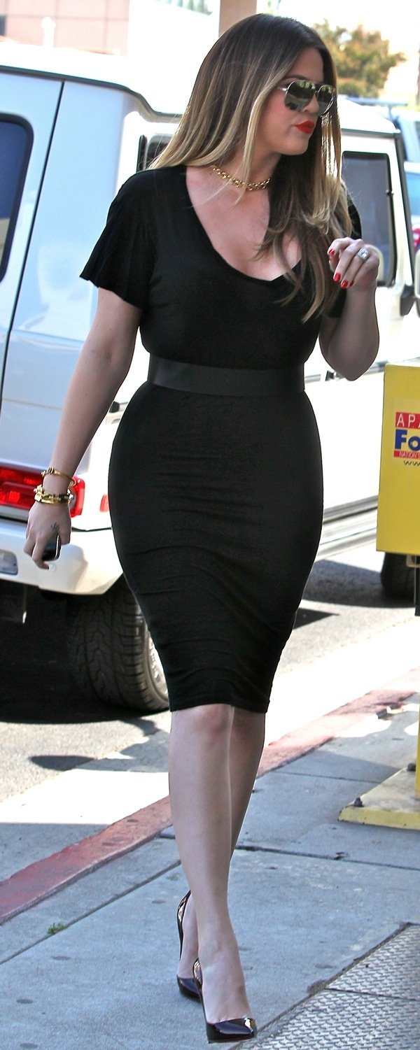 Khloe Kardashian, accused by Ellen Pierson of not being Robert Kardashian's biological daughter, shows off her slim figure in a figure-hugging black dress