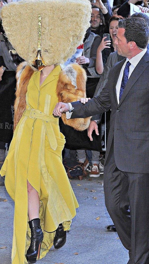 Lady Gaga holding on to her bodyguard as she leaves the Ritz Carlton hotel in Berlin, Germany, on October 24, 2013