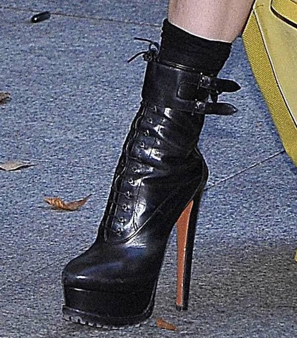 Lady Gaga finished off her look with a familiar pair of lace-up platform boots from Azzedine Alaïa