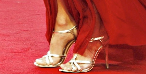 Natalie Portman shows off her feet in gold sandals from Charles David