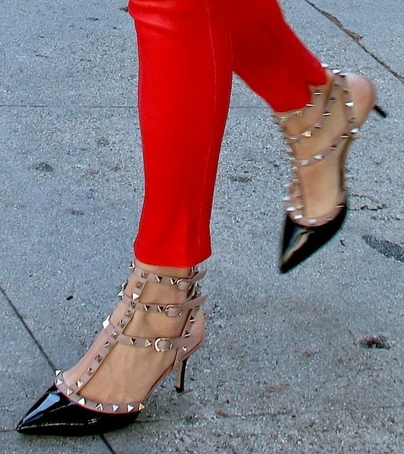 Rebecca Romijn sporting red leather skinnies and a pair of studded pumps from Valentino while shopping around Beverly Hills, California, on October 8, 2013